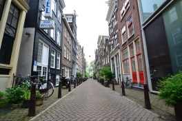 A beautiful street in Amsterdam, you could see a canal at the end of this street
