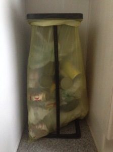The yellow sack in action - stands like this can be purchased at grocery stores such as Globus
