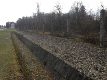 Perimeter fencing and ditch with a stream on the other side, all were guarded by watch towers